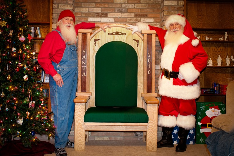 Santa Jim poses with his Builder Brother, Arthur, next to his custom Santa throne.