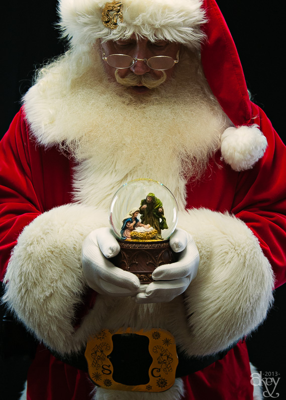 Santa Jim holds a nativity snowglobe